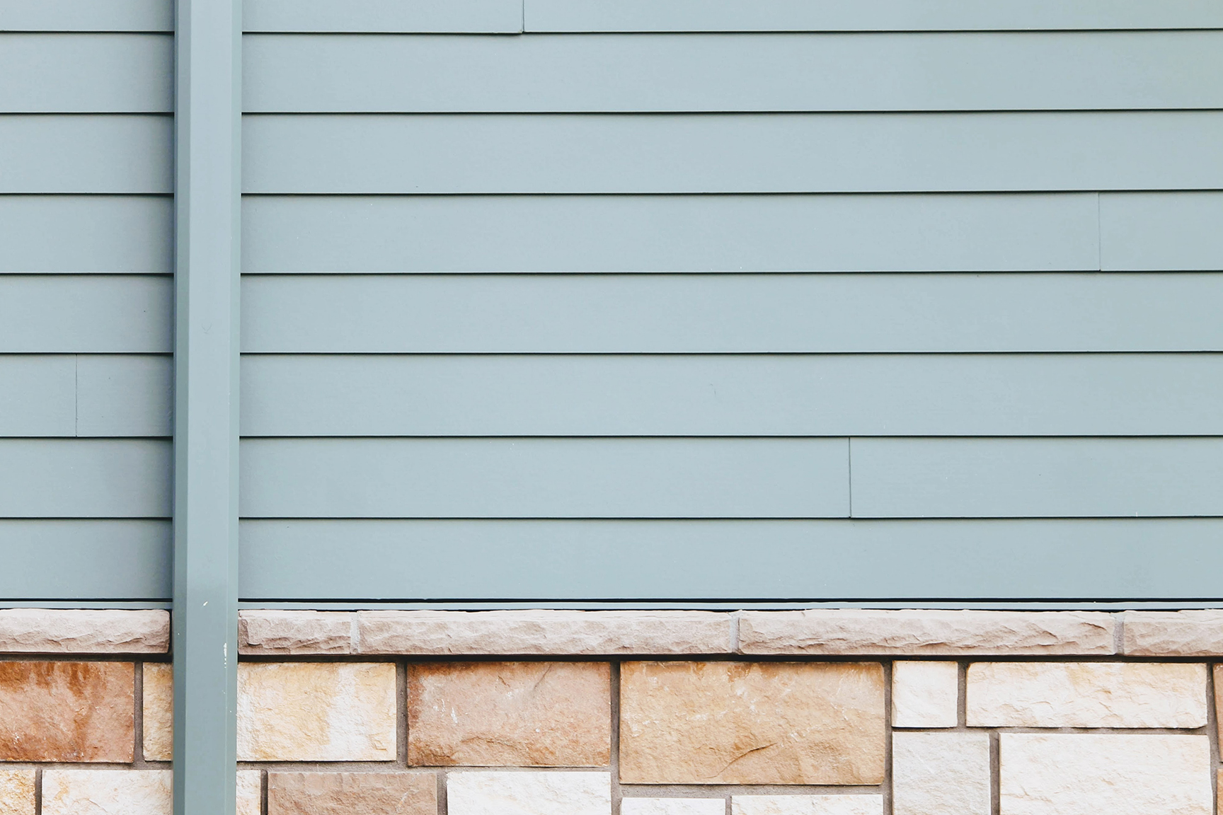 does pressure washing damage vinyl siding